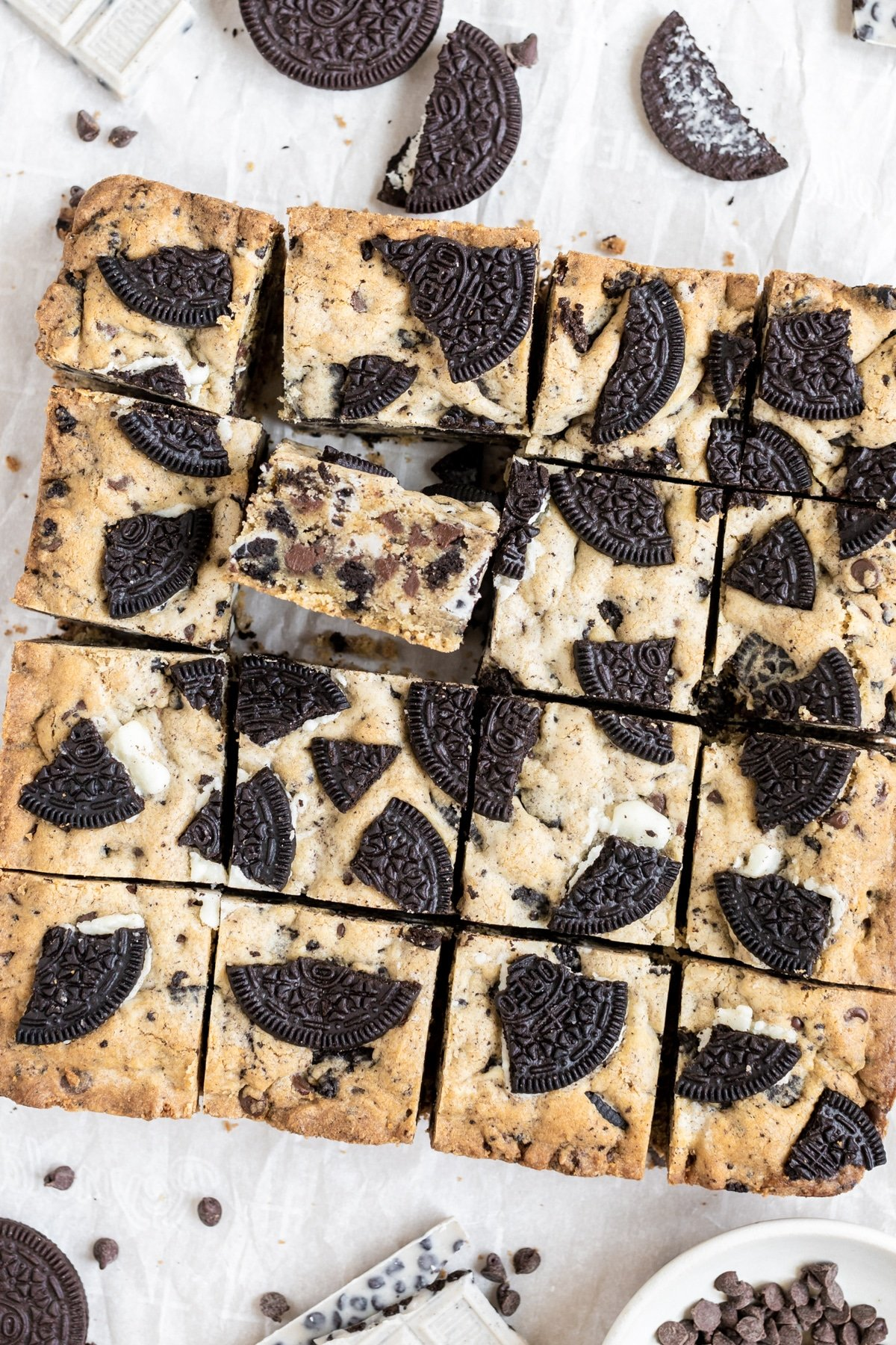 cookies and cream bars on a piece of parchment paper, cut into square bars