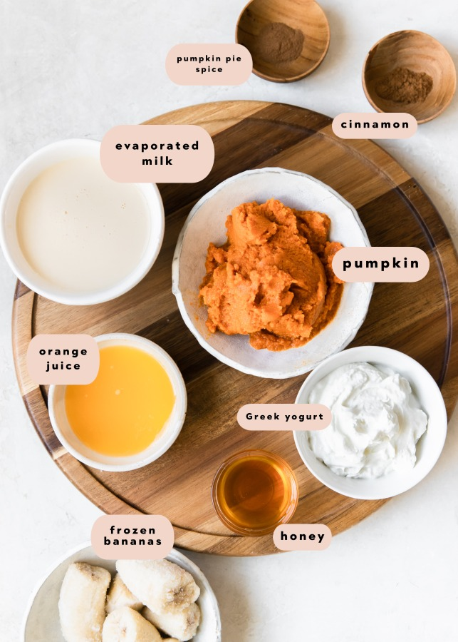 ingredients portioned out into small bowls on a wooden board